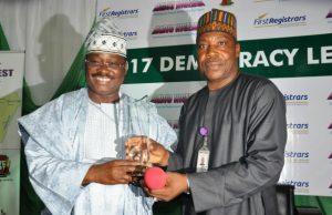 Zonal Director, Radio Nigeria Ibadan Network Centre, Mr Muhammed Bello (right), presenting an Award to Oyo State Governor, Senator Abiola Ajimobi