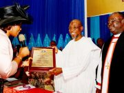 Governor State of Osun, Ogbeni Rauf Aregbesola (middle) receiving a plaque from wife of the Bishop Osun North East Anglican Diocese, Professor (Mrs) Motunrayo Olumakaiye and Bishop Humphrey Olumakaiye, during the event…