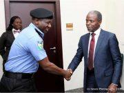 Acting President Yemi Osinbajo, right, with IGP Idris...