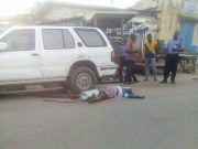 ...the remains of the aged woman killed by rampaging drivers lying on the street in Osogbo...