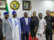 L-R: Editor Michael Effiong, Prince Damola Aderemi, Basorun Dele Momodu, Governor Akinwunmi Ambode and other crew members of Ovation Magazine...