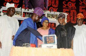 L-R: Chief Gani Adams, Semiu Okanlawon and wife, Governor Rauf Aregbesola and Dr Adebayo Adewusi...during the cake cutting aspect of the event...