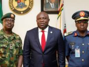 Governor Akinwunmi Ambode, middle, with top military officers after the meeting...