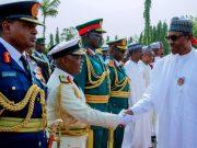President Muhammadu Buhari, right, with Service Chiefs...