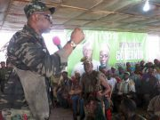 Governor Ayodele Fayose, left, addressing the Local Hunters in Ekiti..