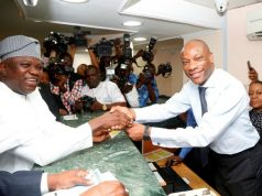 Lagos State Governor Mr. Akinwunmi Ambode (right), being presented with his Land use Charge receipt by the Managing Director, Guaranty Trust Bank (GTBank), Mr. Segun Agbaje (left) at GTBank Opebi, Ikeja, to flag off the e-tax payment campaign on Monday, February 19, 2018…